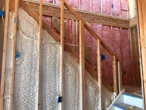 spray foam and fiberglass insulation around stairs